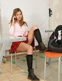 Teen schoolgirl pleasing her pussy with a dildo in class